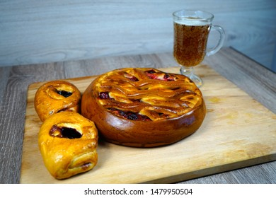 Cherry pie and currant pies and a glass of kvass.