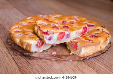 Cherry pie . A piece of cake with cherries . Freshly baked cake from the oven .