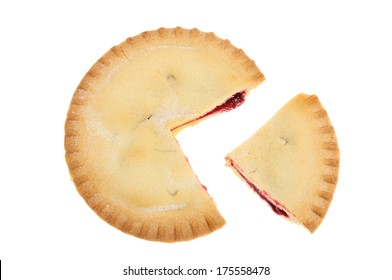 Cherry pie with a slice cut out isolated against white