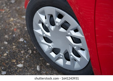 Cherry red car front detail with big light-alloy wheel. - Shutterstock ID 1641243931