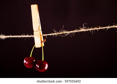 Cherry and rope on black with clamp