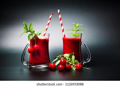 Cherry smoothie with mint leafs in glass