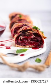 cherry strudel with sauce and chocolate