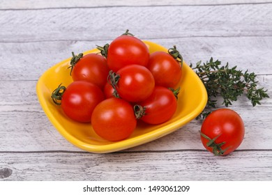 Cherry tomato in the bowl served thyme branch