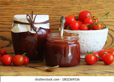 Cherry tomato and chili jam preserves in a jar .