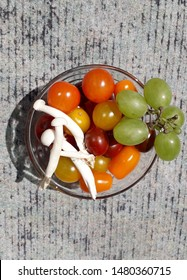 Cherry tomato with japanese white shimeji mushroomd in a trasparent bowl