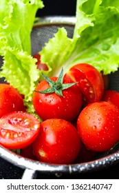 Cherry tomato and leaf salad in a colander