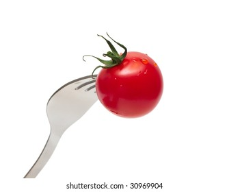 cherry tomato on the fork isolated