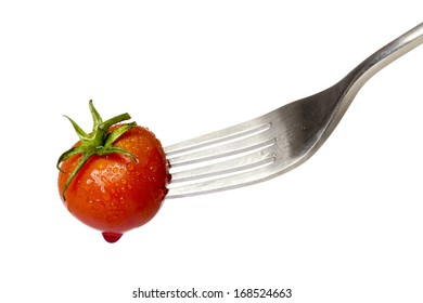 cherry tomato spiked by a fork with a drop of blood, isolated on white.