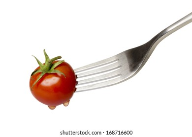 cherry tomato spiked by a fork , isolated on white.