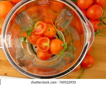 Cherry tomatoes in blender for making juice isolated