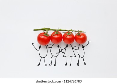 cherry tomatoes with hand drawing shapes of friends or team