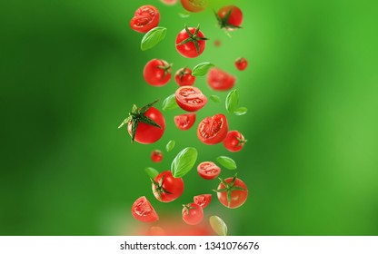 Cherry tomatoes and leaves falling from the air