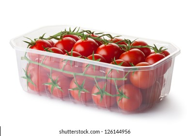 Cherry tomatoes on a branch in retail packaging. Isolated on a white.