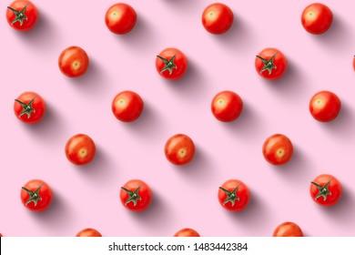 Kirschtomaten auf buntem Hintergrund. Muster von Kirschtomaten. Veganer-Konzept. Zusammensetzung der Tomaten