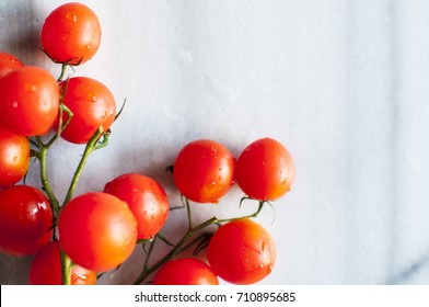 Cherry tomatoes on marble background, close up, selective focus