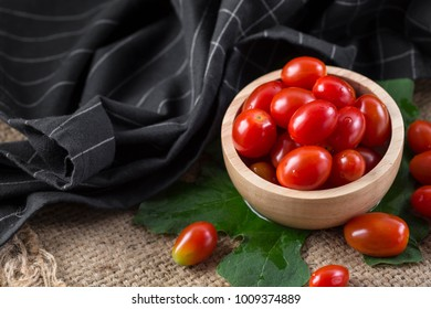 Cherry tomatoes on sackcloth background