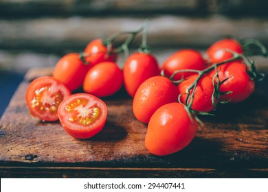 cherry tomatoes on the vine on a rustic background