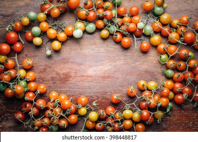 Cherry tomatoes on wooden table close up