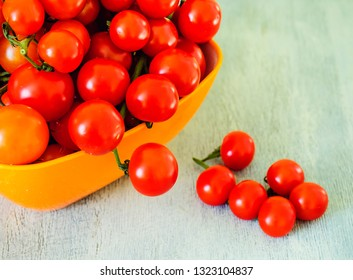 Cherry tomatoes in a plastic bowl