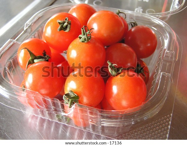 Cherry tomatoes in a plastic container.