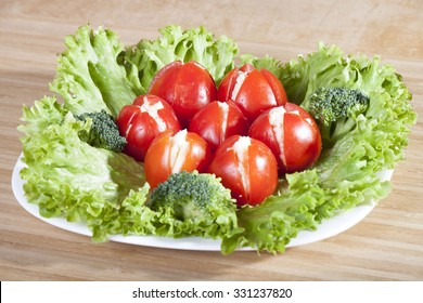 Cherry tomatoes stuffed with cheese