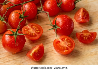 Cherry tomatoes - water drops- wood background