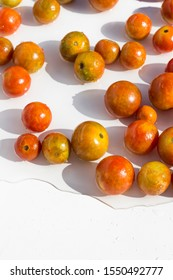 cherry tomatoes in the water on white background
