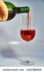 Cherry wine poured into wine glass