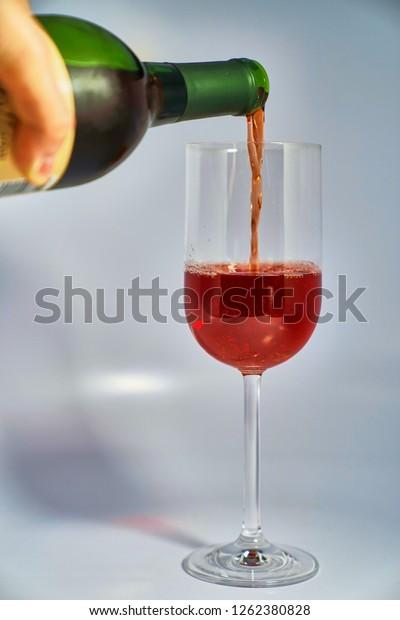 Cherry wine poured into wine glass