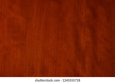 Cherry wood color sample chip with vertical grain.