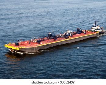 Chesapeake Bay barge guided by a tugboat