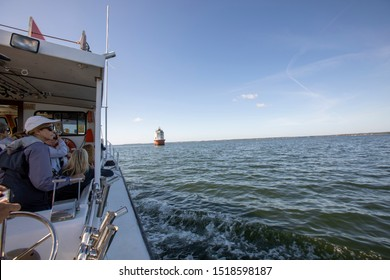 Chesapeake Bay, Virginia - September 20, 2019 :  Sightseers on boat touring Point No Point Ligth in Chesapeake Bay off coastal Virginia.