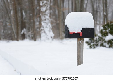 CHESHIRE, CONNECTICUT, USA - FEBRUARY 09, 2017: A mailbox covered with twelve inches of snow after winter storm Niko.