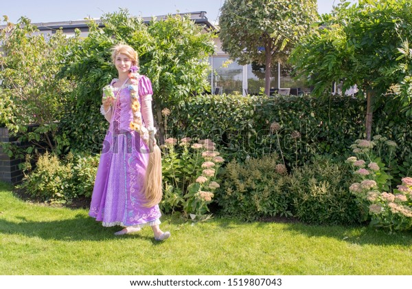 Cheshire, England - August 18th, 2019 : Chester Comic Con - Rapunzel Cosplayer
