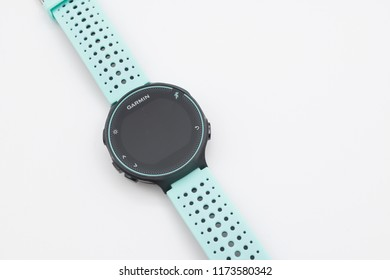 Cheshire, England - August 31st, 2018: Garmin Forerunner 235 Fitness Tracking Watch  on Black and Blue