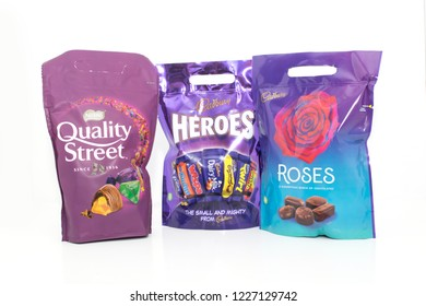 Cheshire, England - November 11th, 2018: Nestle Quality Street, Cadburys Heroes and Cadburys Roses on a white background