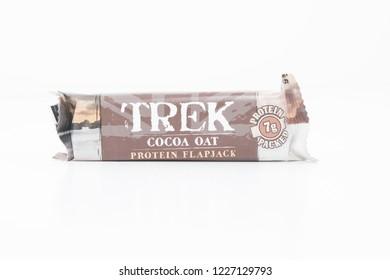 Cheshire, England - November 11th, 2018: Trek Cocoa Oat Protein Flapjack on white background