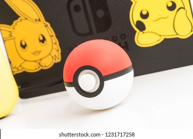 Cheshire, England - November 16th, 2018: Special Edition Pokemon Lets Go Pikachu Nintendo Switch on White Background