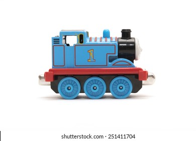 CHESHIRE, UK - February 9 2015. Thomas the Tank Engine toy, based on children's books by the Reverend Wilbert Awdry isolated on white background