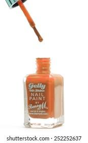 CHESHIRE, UK - February 9 2015. Orange Gelly Hi Shine Nail Polish by Barry M isolated on a white background