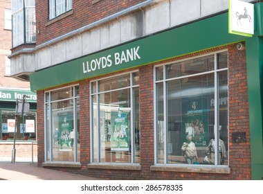 Cheshire, UK- June 4th 2015: Lloyds bank branch with sign and logo.  Lloyds Bank has been hit with record fines after the PPI mis selling scandal in the UK.
