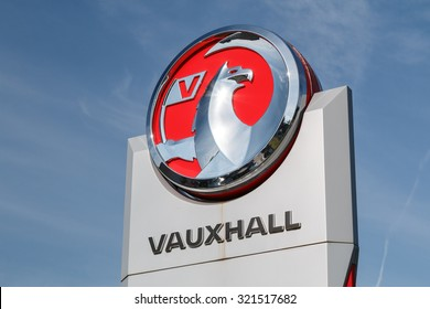 Cheshire,UK - March 6th 2017: Vauxhall logo on a sign outside the car or automotive dealership.Vauxhall is to be purchased by the French PSA group.