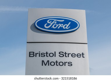 Cheshire,UK - September 28th 2015: Ford logo on a sign outside the car or automotive dealership. All car brands are under scrutiny after the VW emissions scandal.