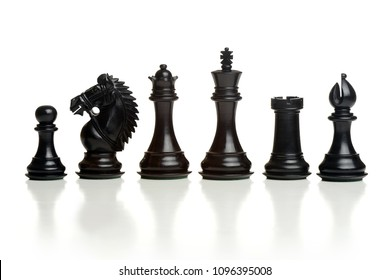 Chess black pieces isolated on a white background