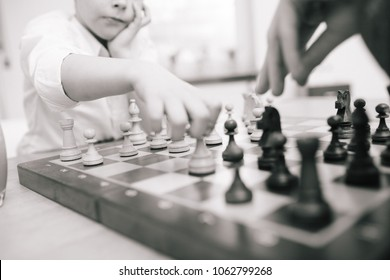 Chess board with child playing, shallow focus are and monochrome processing