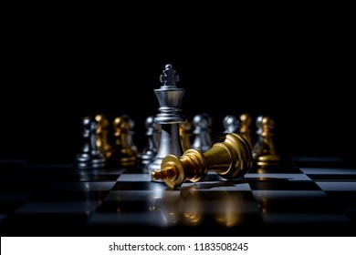 Chess board game for business concept in light and shadow.