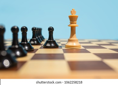 Chess board and game concept. Business ideas, competition, strategy and new ideas concept. Chess figures on blue background. Selective focus. Side view. Win, victory, winner concepts