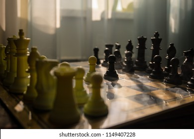 chess board game concept of business ideas and competition and strategy ideas. Chess figures on a background with window. Selective focus