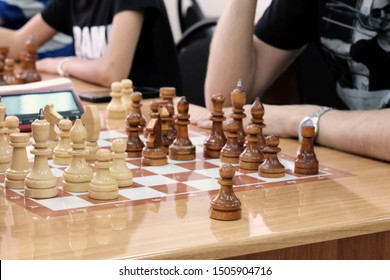 Chess, Board game. The game concept. Developing the abilities of using old games. People of different ages playing at the tables in rapid chess